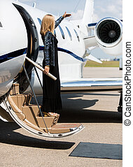 Woman Stepping Out Of Private Jet