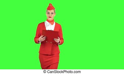 Woman steps along with a red folder in her hands. Green screen