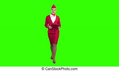 Woman steps with a red folder in her hands . Green screen. Slow motion