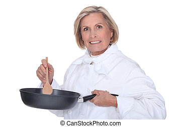 Woman stirring sauce