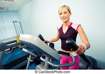 Woman - Image of pretty girl in sportwear on the treadmill...