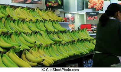 Woman Stocking Bananas
