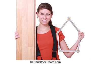 Woman stood with laminate flooring