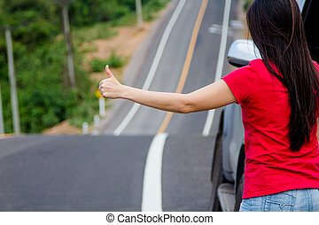 Woman stopping car