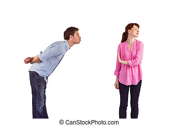 Woman stopping man from kissing