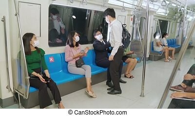 Woman stops man from sitting next to her on train for social distancing .