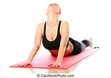 A picture of a young woman lying on a mat and streching over white background