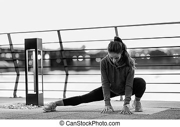 Woman streching after training