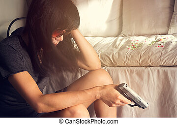 woman stress and depressed of her sickness, she decided to kill herself with a gun in hand