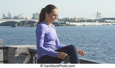 Woman stretches her legs before exercise