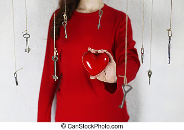 woman stretches out his hand with a shape of red heart