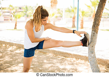 Woman stretching after a run