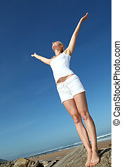 Woman stretching arms up from freedom