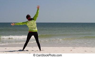 Woman Stretching Beach