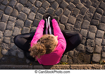woman stretching before morning jogging