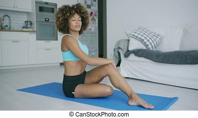 Woman stretching body training on mat