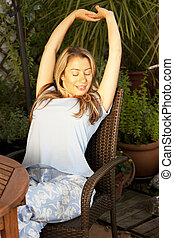 woman stretching her arms on the terrace