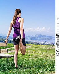 Woman stretching in the park - Photo of a young woman...