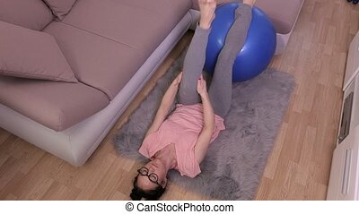 Woman stretching legs after workout
