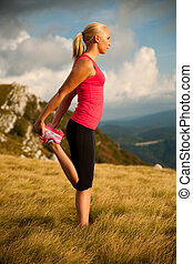 woman stretching muscles after workout outdoor
