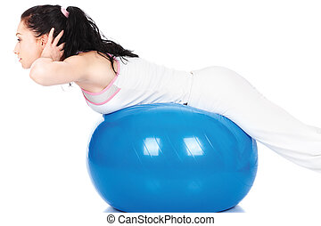 Woman stretching on the blue ball