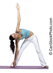 woman stretching on yoga mat