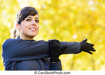 Woman stretching shoulder