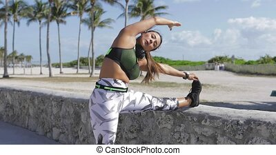 Woman stretching with eyes closed - Attractive young woman...