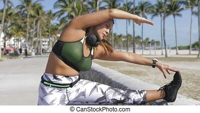 Woman stretching with eyes closed