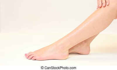 Woman stroking her smooth legs