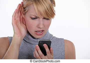Woman struggling to have a conversation on speaker phone