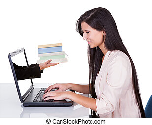 Woman studying at laptop