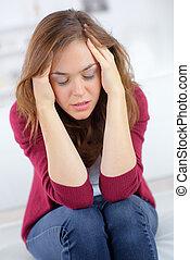 Woman suffering from a headache