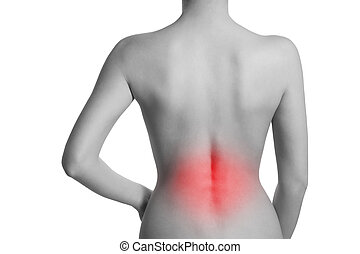 Woman suffering from backache. The lumbar spine is...