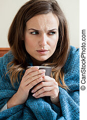 Woman suffering from cold - Vertical view of woman suffering...