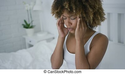 Woman suffering from headache - Ethnic young model in home...