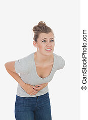 Woman suffering from menstruation pain - Young woman...