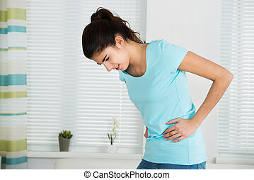 Woman Suffering From Stomach Ache At Home