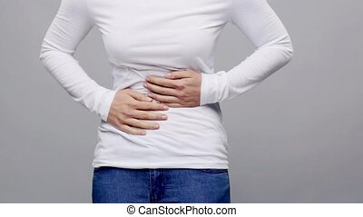 woman suffering from stomach ache - people, healthcare and...