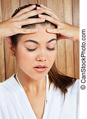 Woman Suffering Headache - Close up of young woman in ...
