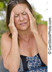 Woman suffering headache pain