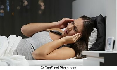 Woman suffering migraine in the night in the bed - Worried...