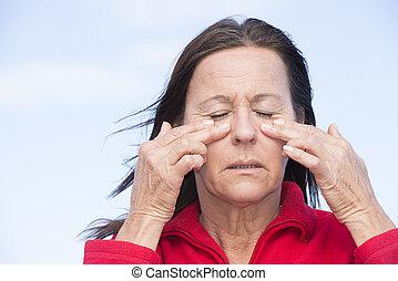 Woman suffering painful headache