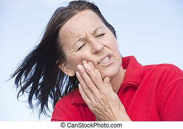 Woman suffering painful toothache