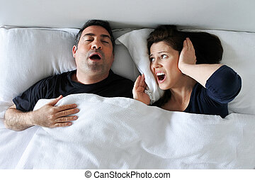 Woman suffers from her partner snoring in bed - Woman (age...