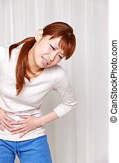 woman suffers from stomachache