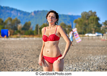 Woman sunbathes at sea tourist resort in summer. - Holiday ...