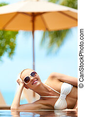 Woman sunbathing in a bikini