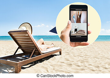 Woman Sunbathing On Deck Chair At Beach - Side view of young...