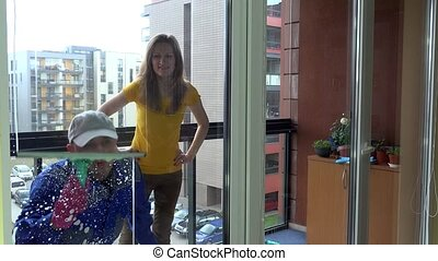 woman supervise and flirt with working window cleaner man....